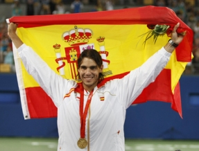 Rafael Nadal of Spain holds up the Spani