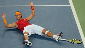 Rafael Nadal of Spain falls to the court